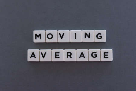 Moving Average word made of square letter word on grey background. Standard-Bild