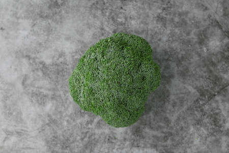 Top view of broccoli on grey,black and white floor. Imagens