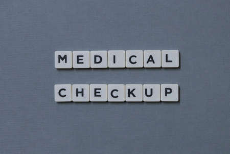 Medical Checkup  word made of square letter word on grey background.