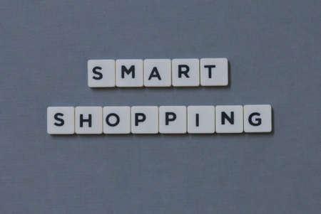 Smart Shopping  word made of square letter word on grey background.