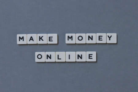 Make Money Online  word made of square letter word on grey background.