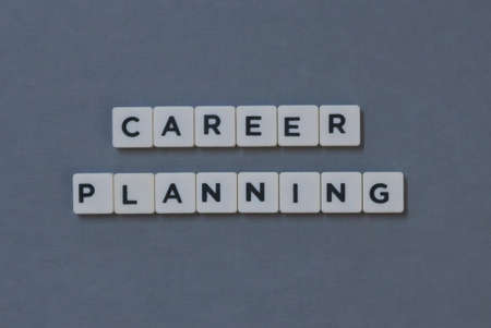 ' Career Planning ' word made of square letter word on grey background.