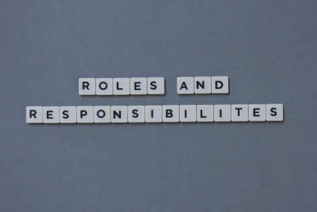 ' Roles And Responsibilities ' word made of square letter word on grey background.