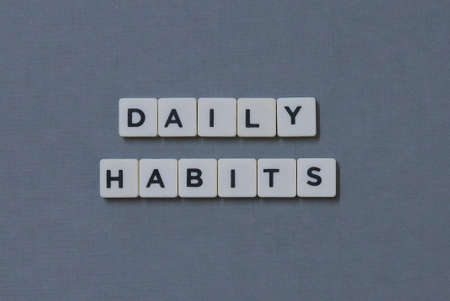 Daily Habits  word made of square letter word on grey background.