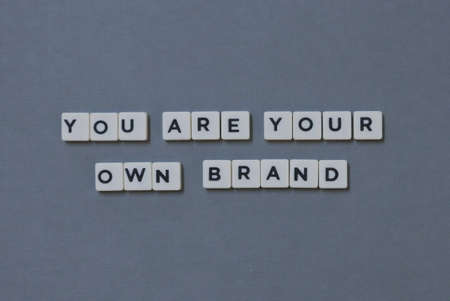 You Are Your Own Brand  word made of square letter word on grey background.