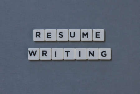 Resume Writing  word made of square letter word on grey background. Imagens