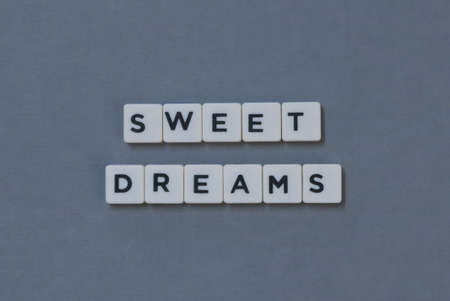 Sweet Dreams  word made of square letter word on grey background. Imagens