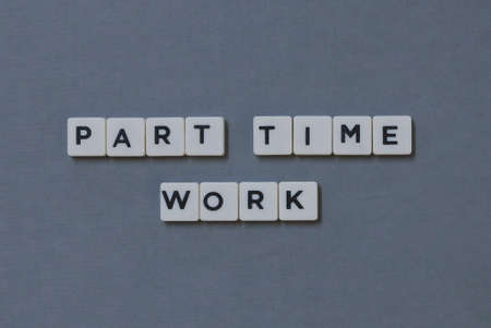 Part Time Work  word made of square letter word on grey background.