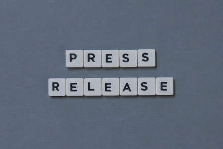Press Release  word made of square letter word on grey background.
