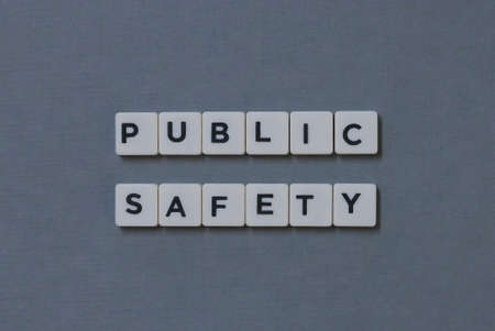' Public Safety ' word made of square letter word on grey background.
