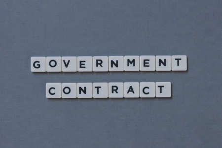Government Contract  word made of square letter word on grey background. Imagens