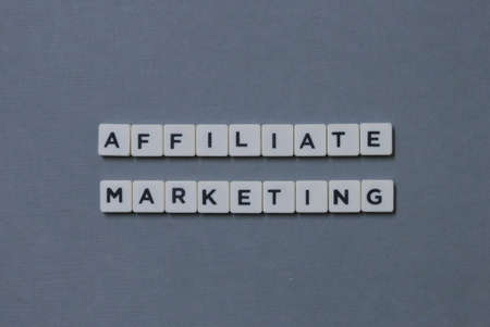 Affiliate Marketing  word made of square letter word on grey background.