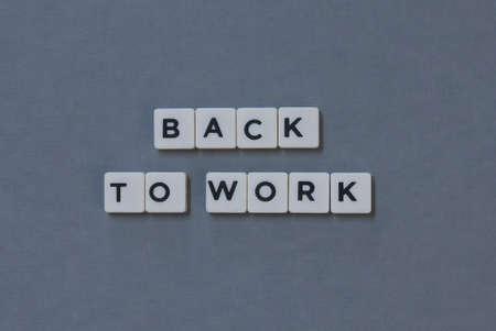 Back To Work  word made of square letter word on grey background.