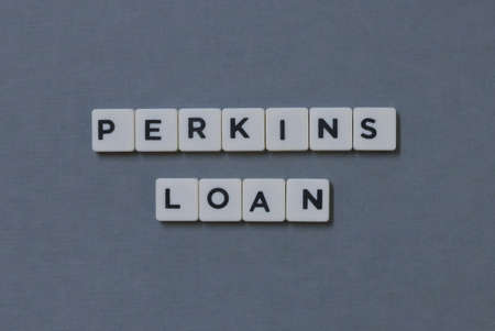 Perkins Loan  word made of square letter word on grey background.