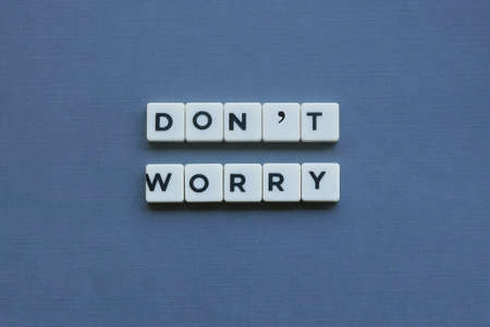 ' Don't Worry ' word made of square letter word on grey background. 写真素材