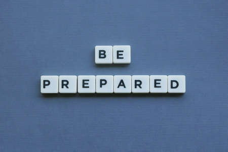 ' Be Prepared ' word made of square letter word on grey background.
