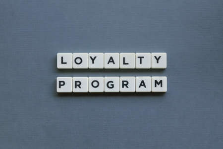 ' Loyalty Program ' word made of square letter word on grey background.