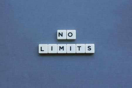 """ No Limits ' word made of square letter word on grey background."