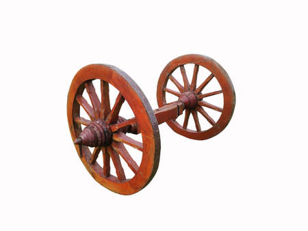 Old grunge and rustic wooden wheel isolated on white background.