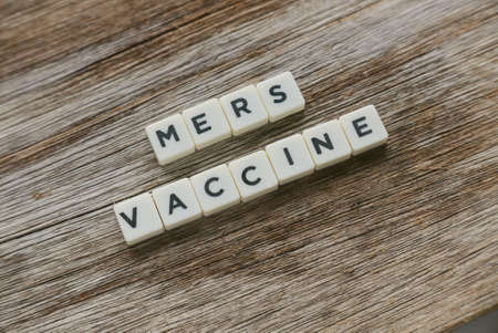 Word Mers Vaccine alphabet on wooden