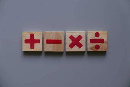 Top view of wooden Addition, subtraction, multiplication and division. They are four basic operations of elementary arithmetic. Stock fotó