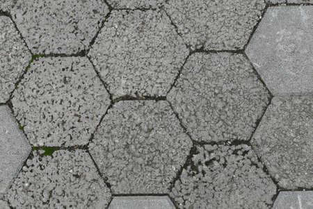 Top view of Gray interlocking paving stone driveway.