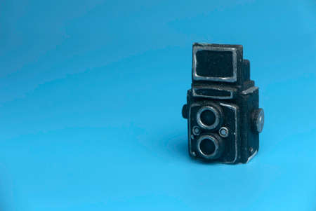 Selective focus of miniature camera isolated on a blue background with a copy space. 版權商用圖片