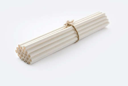 Biodegradable eco friendly white paper drinking straw isolated on white background