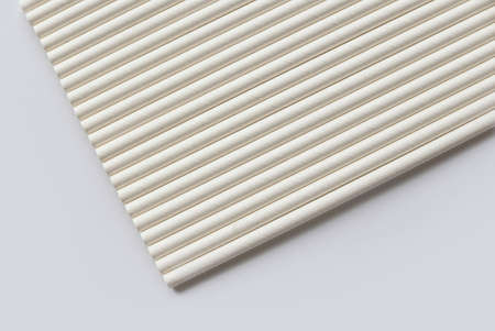 A row of biodegradable eco friendly white paper drinking straw isolated on white background