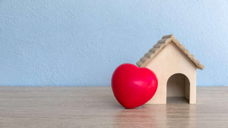 A house model and red heart love on table with copy space.