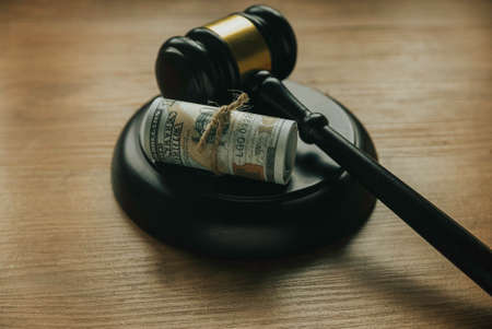 Gavel and bank note on wooden table concept. 版權商用圖片