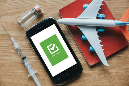 Digital health vaccination passport app concept display on mobile phone for travel during covid-19 pandemic.