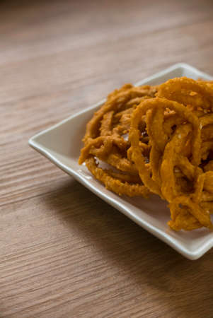 Murukku is a savory, crunchy snack originating from the Indian subcontinent.Its an Indian traditional tea time snack chakli, a deep fried snack, It is known as Chakali, Muruku, Murkoo, Chakri.