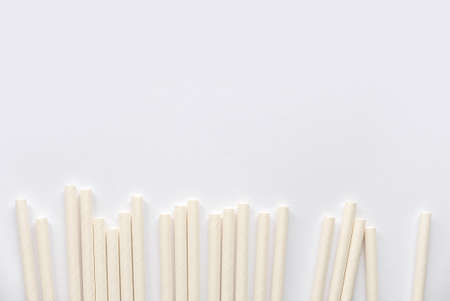 Biodegradable eco friendly white paper drinking straw isolated on white background with copy space.