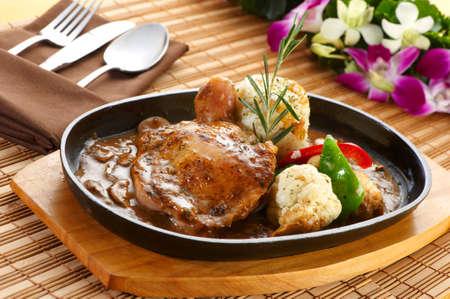 Rice with chicken and mushroom gravy Stock Photo
