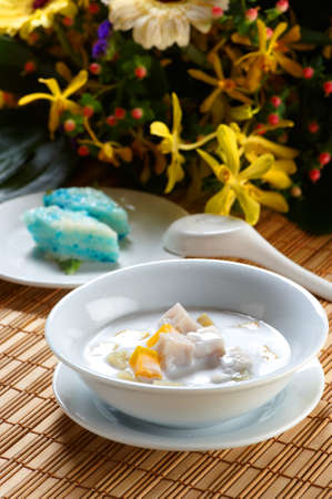 A bowl of yam and mango chacha dessert