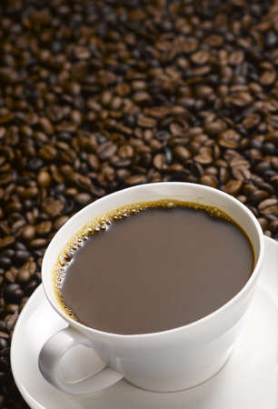 A Cup Of Coffee With Coffee Bean Background Stock Photo
