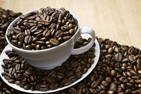Black Coffee bean with wood background