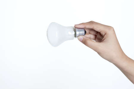 Save The Energy With Hand holding a bulb