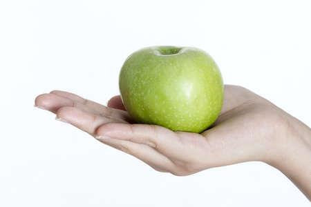 Close Up of Green Apple with beautiful Hand