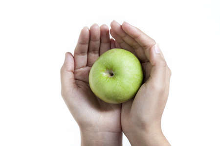 Go green Apple close up with hands