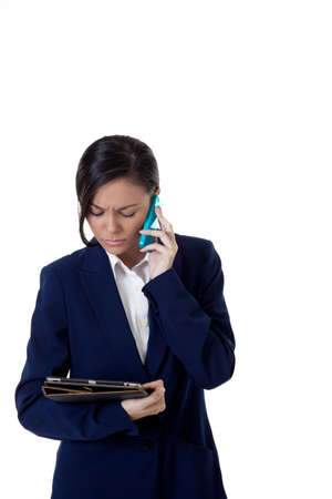 Young business women talk on the phone with looking at note book