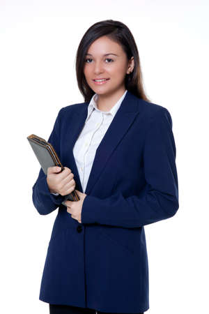 Young Saleswomen holding a note book on the white background photo