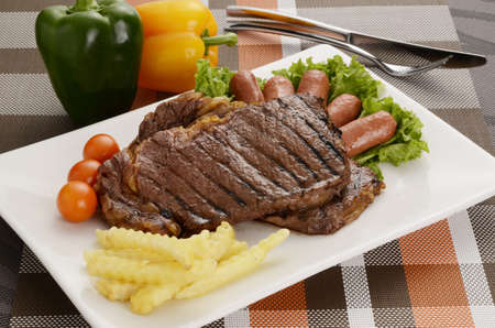 Beef Steak With Sausage Stock Photo