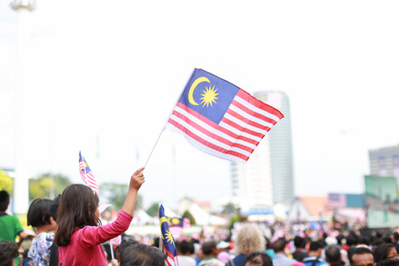 Kid waving jalur gemilang flag Stock Photo