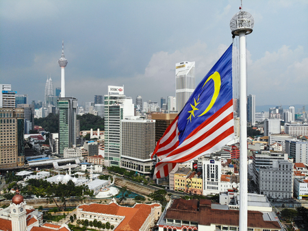 Malaysia Flag Waving with cityscape background Editorial