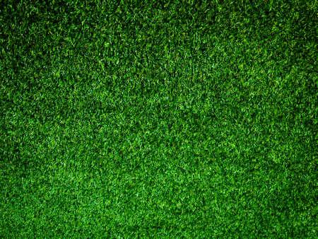 Nahaufnahmeansicht des Fußballfeldhintergrundes des grünen Grases. Wallpaper für Arbeit und Design.