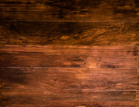 Natural dark wooden background for text and design. Top view