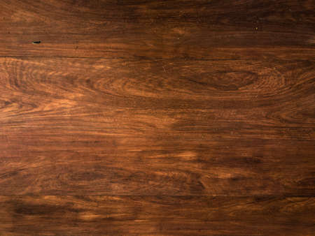 Walnut planks texture for background with space for work. Top view