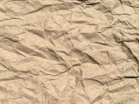 Brown crumpled paper background with copy space for Design. Wrinkled wallpaper Pattern